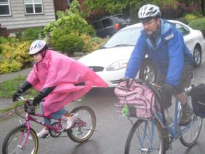 Clint bikes to school with daughter Berkeley